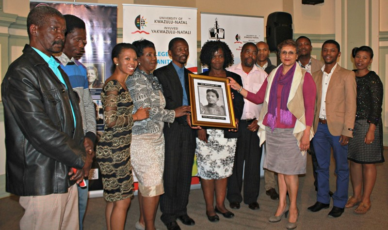 DVC for Teaching and Learning Prof Renuka Vithal hands over the Nokuthela Dube photograph to the Dube family
