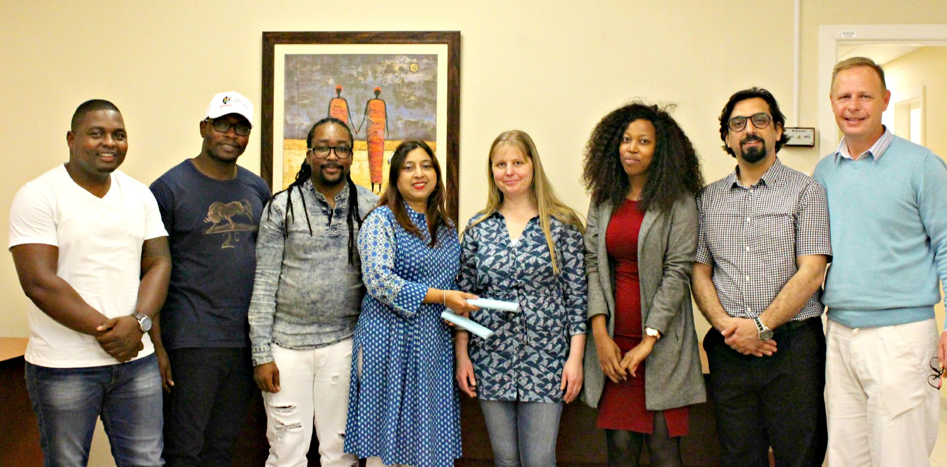 Professor Shanta Balgobind Singh (fourth left) hands over a token of appreciation to Dr My Lilja (fifth left) from the University of Gӓvle. They are seen with staff and the Dean and Head of School, Prof Jean Steyn (eighth left), from the School of Applied Human Sciences.