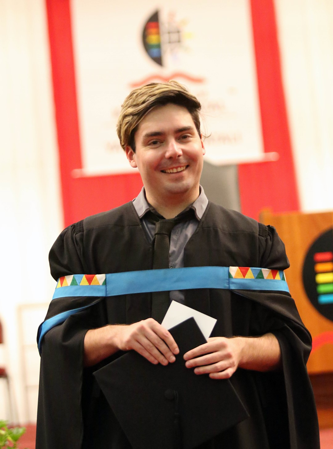 Mr Warwick Jones graduates with his Masters in Arts, cum laude.