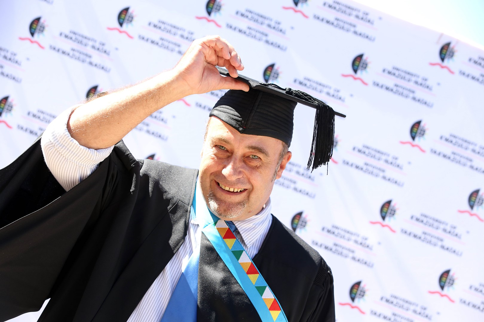 UKZN staffer and filmmaker Mr Michael Hatton graduates with his Masters in Arts.