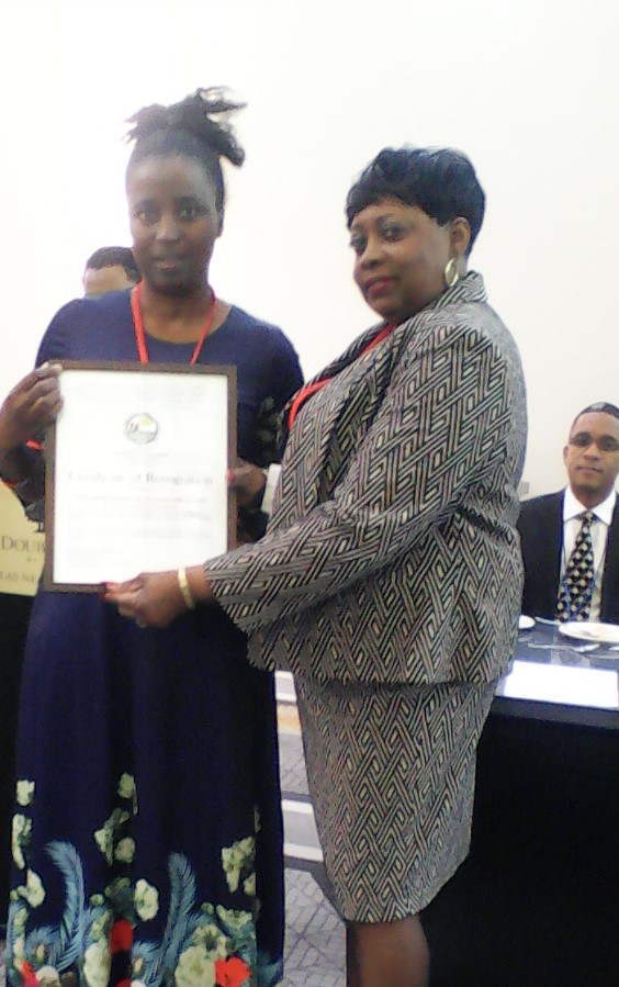 PhD student, Ms Thulebona Shawe is awarded a certificate of recognition from NAAAS.