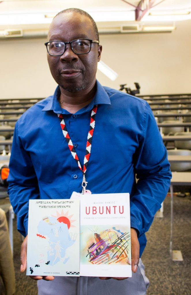 College DVC Prof Mkhize shows off philosophical books by Mogobe Ramose