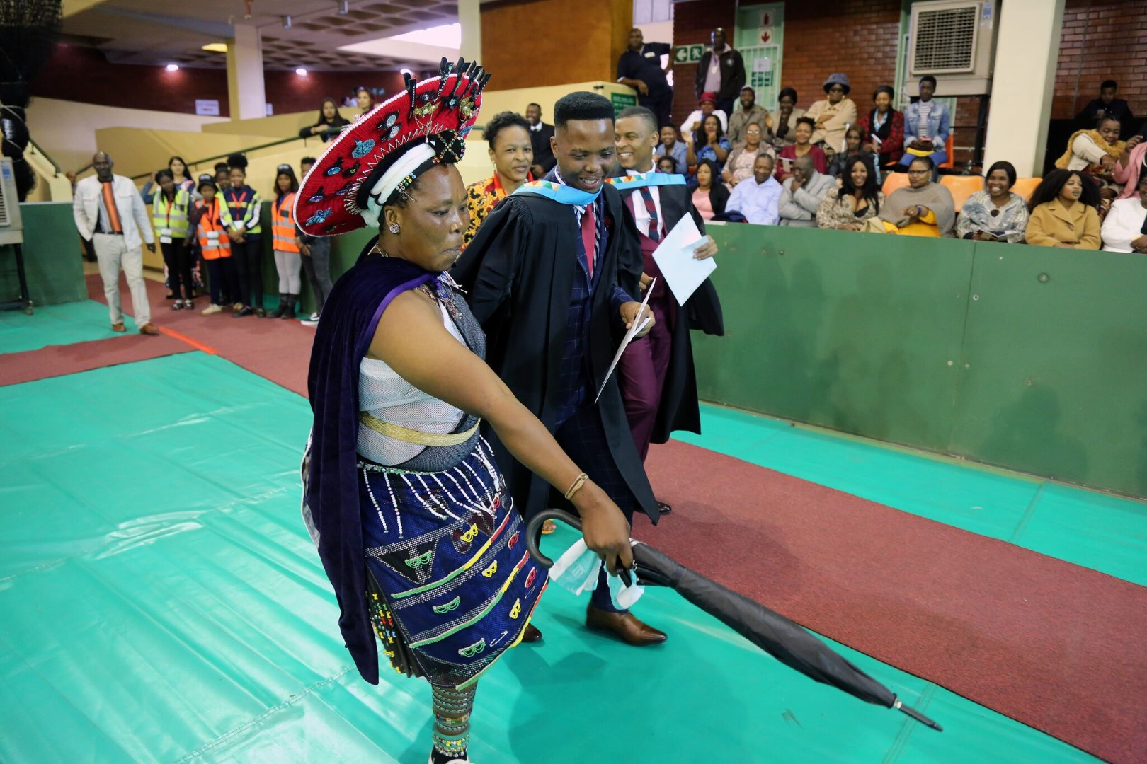 A parent celebrates her son graduating with a degree in Education