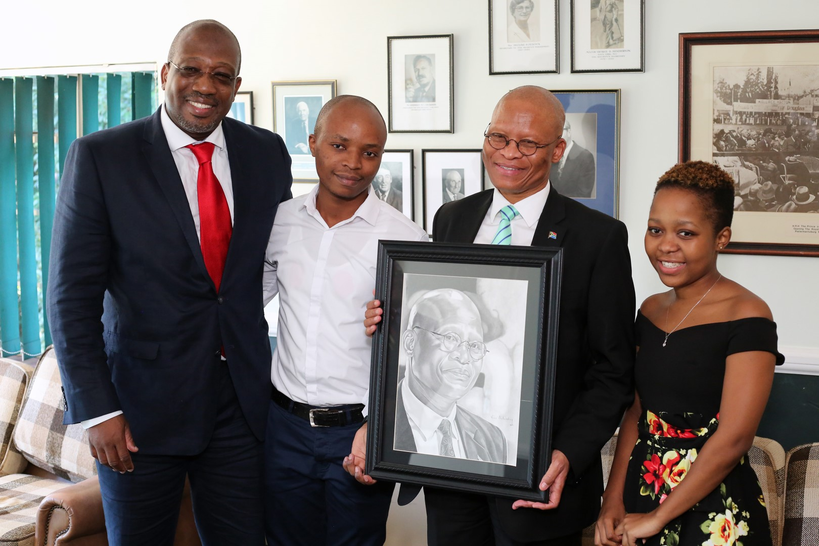 Chancellor Chief Justice Mogoeng Mogoeng together with VC Prof Nana Poku presented with a sketching of himself