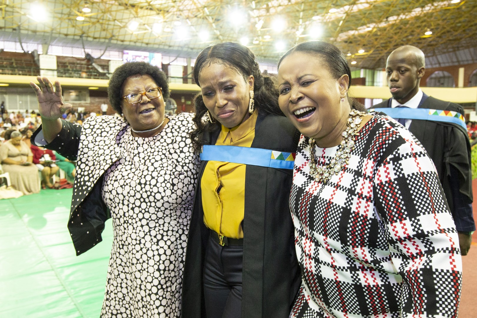 Emotional moment for graduate and family