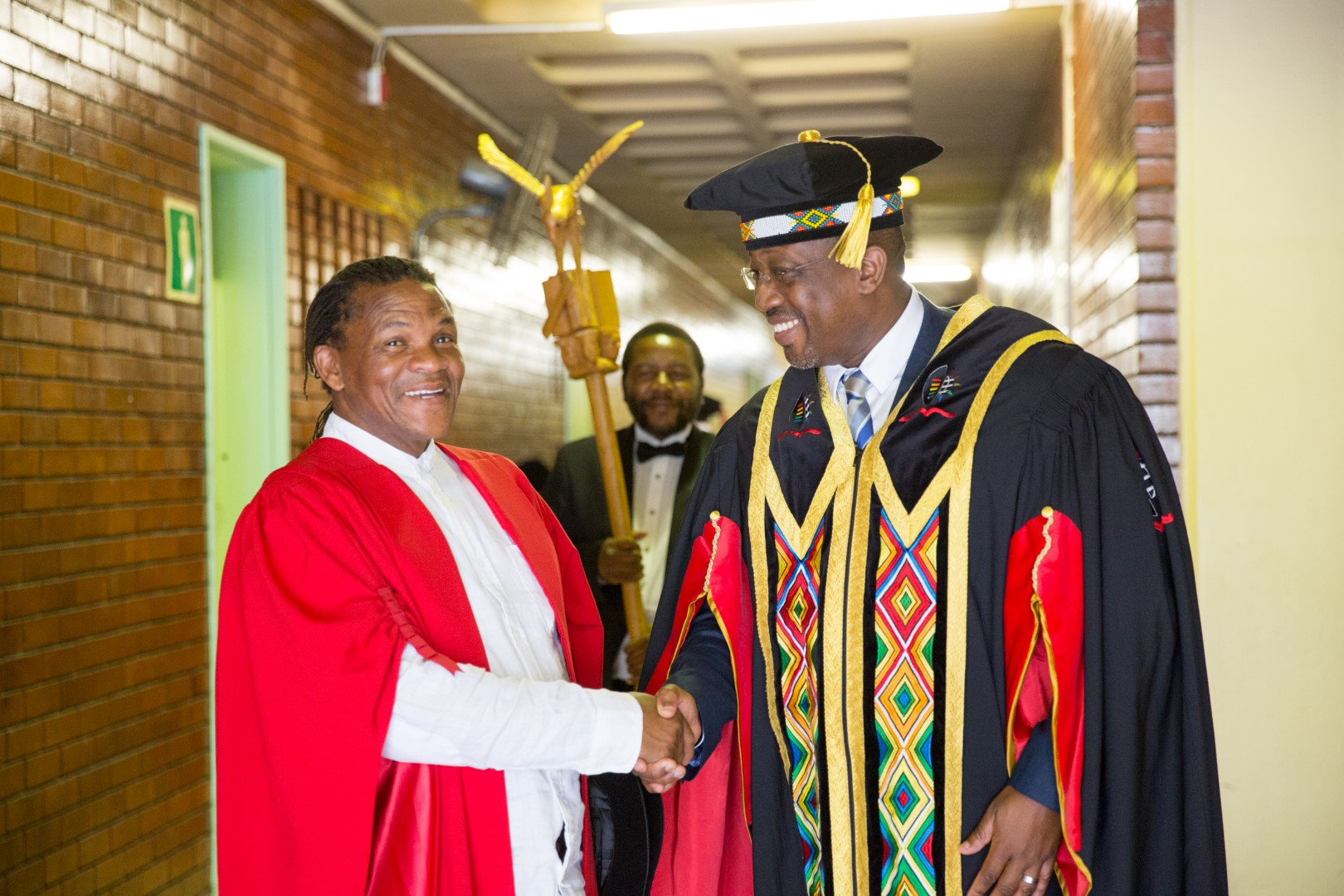 Honorary Graduate Dr Willie Bester shares a lighthearted moment with UKZN Acting VC Prof Nana Poku