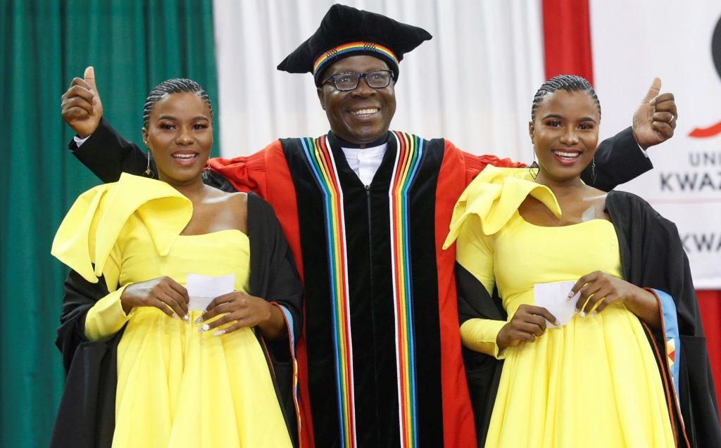 Twins graduate with Education degrees