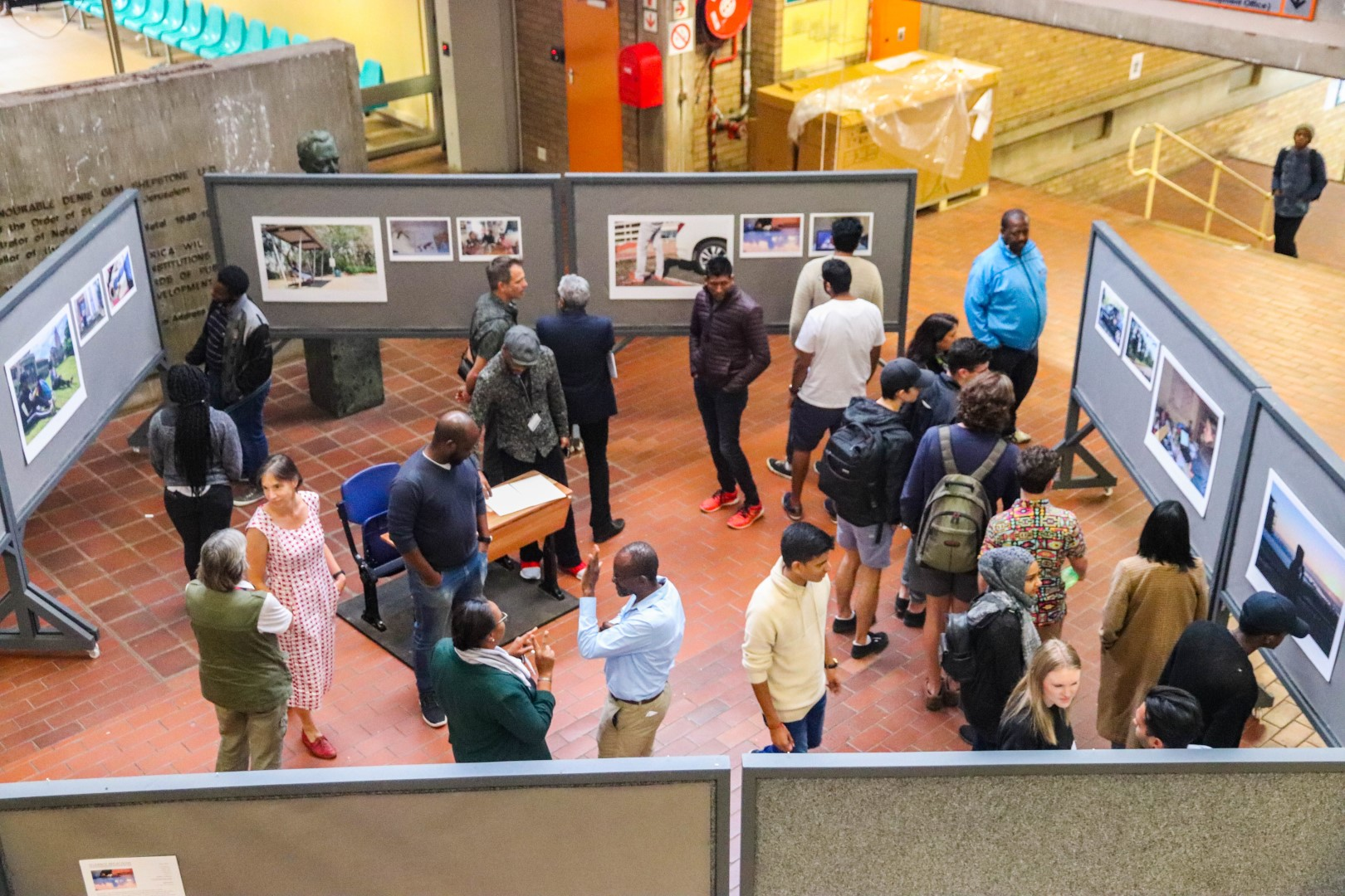 People engage with the exhibit