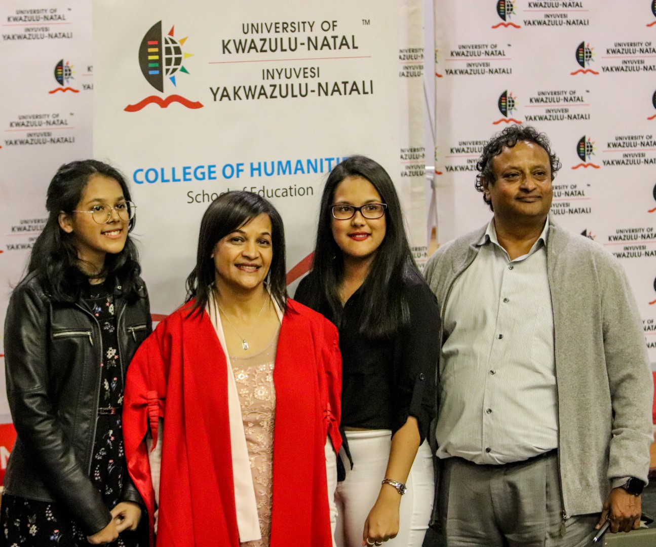 Prof Sarah Bansilal with her daughters and husband
