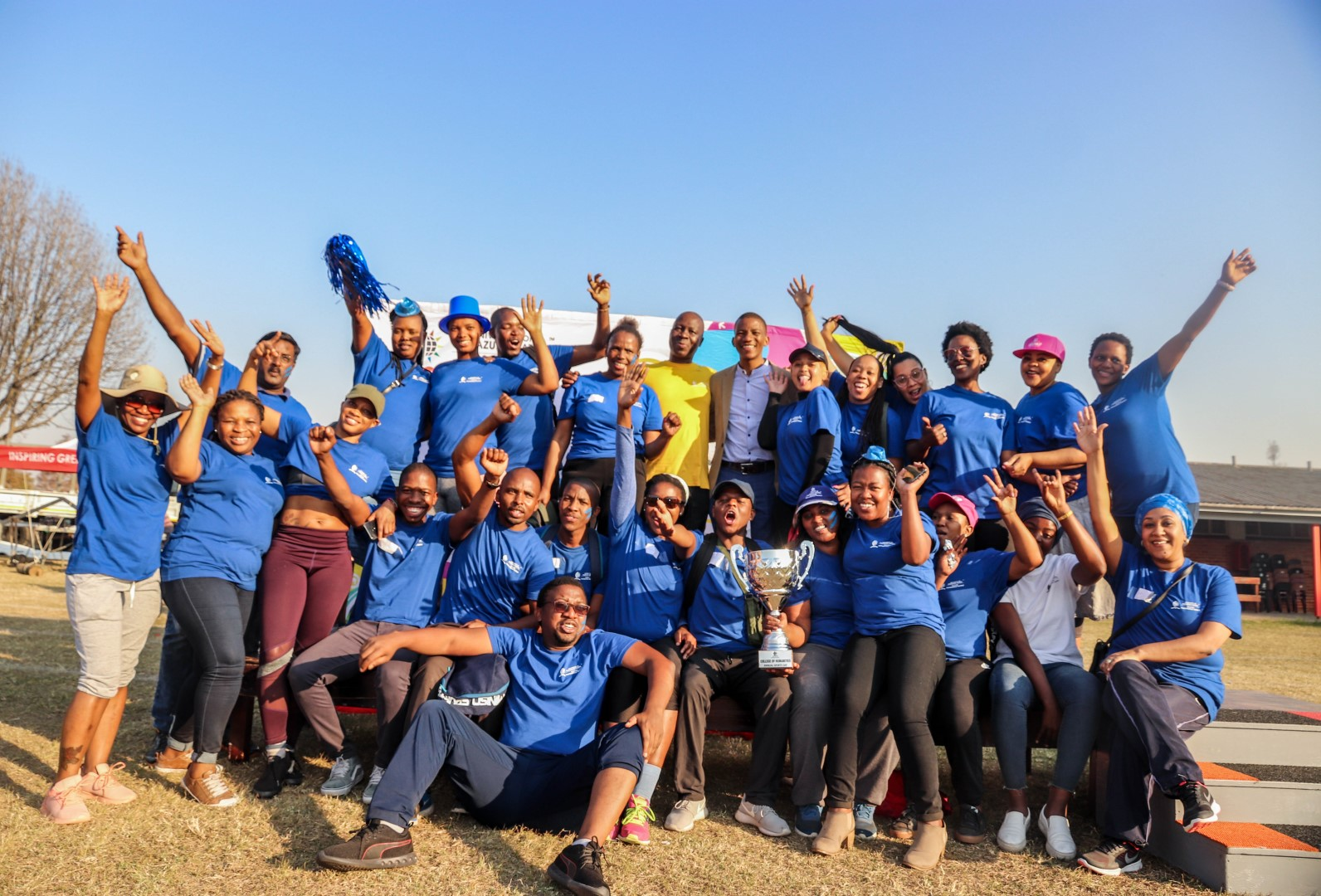 Sports Day champions Blue Fire celebrate their win