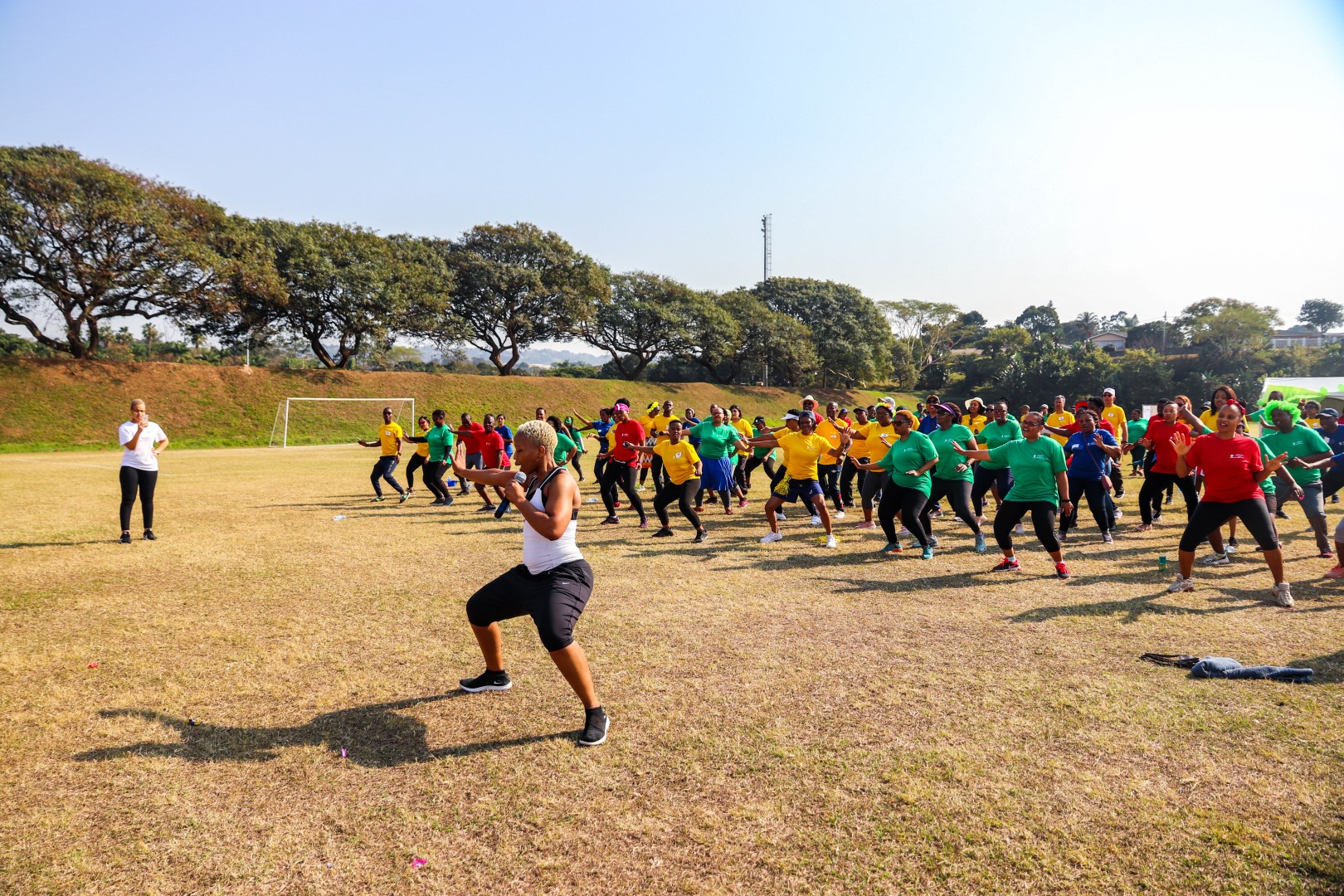 Staff participate in a warm up session of Zumba